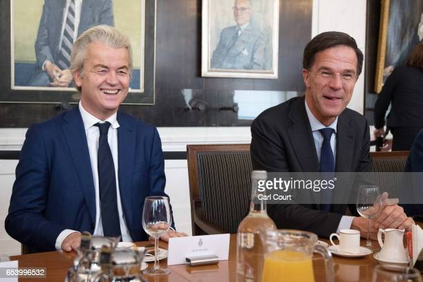 Dutch Prime Minister Mark Rutte and Party for Freedom leader Geert Wilders talk with other party leaders at the beginning of a meeting of Dutch...