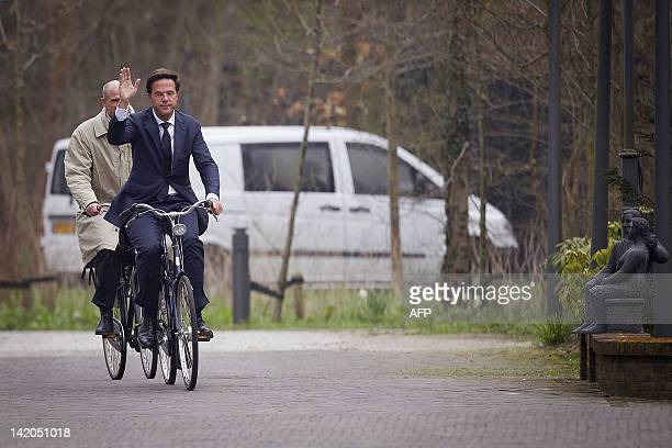 Dutch Prime Minister Mark Rutte and Stef Blok from the People's Party for Freedom and Democracy arrive on their bicycles at Catshuis the official...