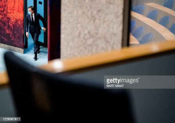 Dutch Prime Minister Mark Rutte attends a debate over developments surrounding the Covid-19 outbreak, during a plenary session in the House of...