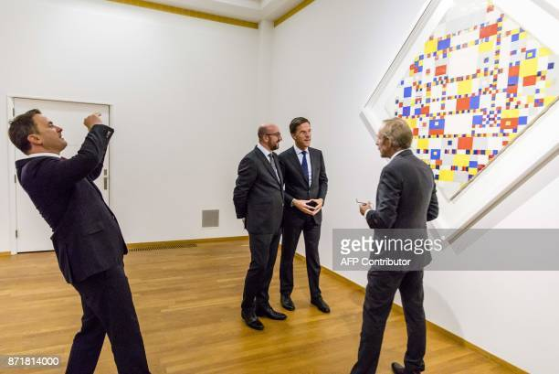 Dutch Prime Minister Mark Rutte Belgian Prime Minister Charles Michel listen to curator Hans Janssen informing about the painting 'Victory Boogie...