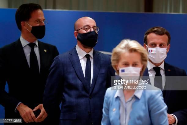 TOPSHOT Dutch Prime Minister Mark Rutte European Council President Charles Michel French President Emmanuel Macron and President of the European...