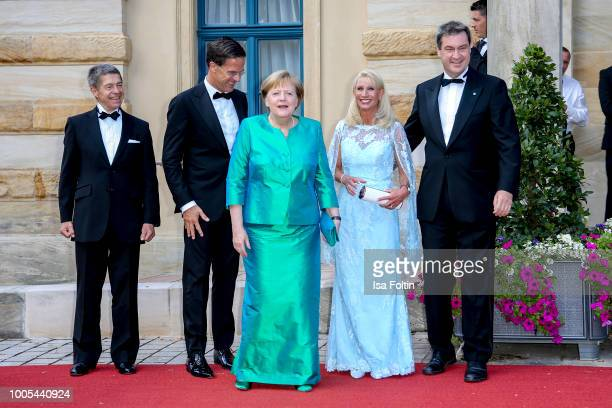 Dutch Prime Minister Mark Rutte, German Chancellor Angela Merkel with her husband Joachim Sauer and Bavarian State Premier Markus Soeder and his wife...