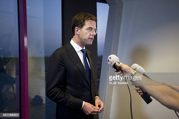 Dutch Prime Minister Mark Rutte gives a short statement to the press at Schiphol Airport near Amsterdam the Netherlands on July 17 2014 regarding the...