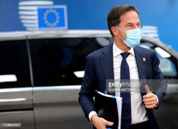 Dutch Prime Minister Mark Rutte gives the thumb up as he arrives on the second day of a European Union summit at The European Council Building in...