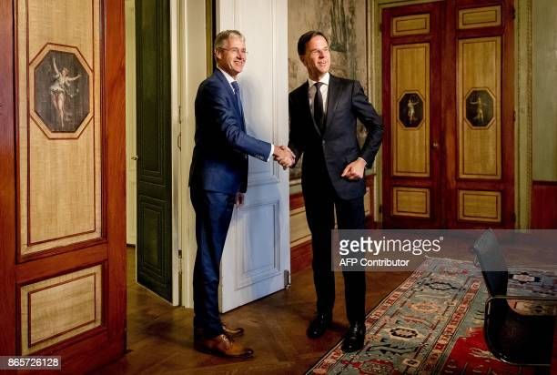 Dutch Prime Minister Mark Rutte in the lead role of his third cabinet meets soon to be Minister of primary and secondary Education and Media Arie...