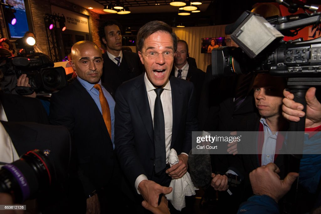 Dutch Prime Minister Mark Rutte is greeted by supporters as he leaves after making a speech following his victory in the Dutch general election on March 15, 2017 in The Hague, Netherlands. Dutch voters have gone to the polls in one of the most tightly contested general elections in recent years.