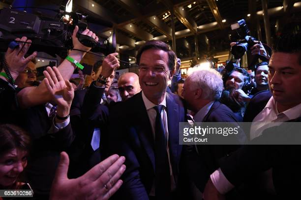 Dutch Prime Minister Mark Rutte is greeted by supporters as he arrives to make a speech following his victory in the Dutch general election on March...