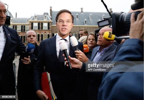 Dutch Prime Minister Mark Rutte of the liberal VVD party speaks to the press as he arrives at the Binnenhof building in The Hague on October 10 2017...