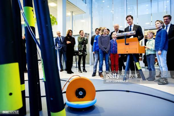 Dutch Prime minister Mark Rutte opens the Amsterdam International Water Week with children who designed the Minoct robot which creates clean drinking...