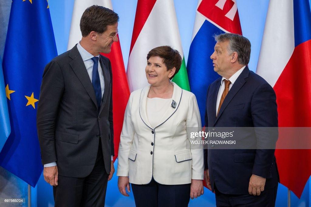 Maurits Hendriks Netherlands Prime Minister Mark Rutte L: Dutch Prime Minister Mark Rutte, Polish Prime Minister