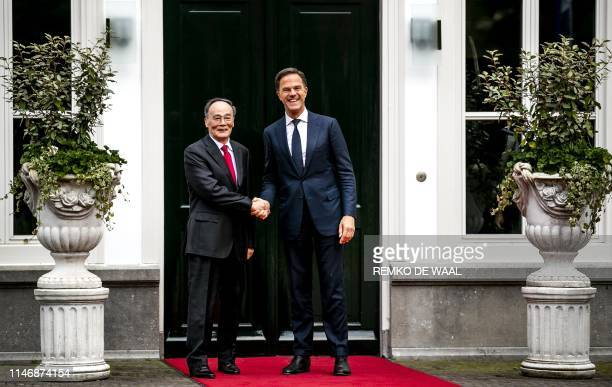 Dutch Prime Minister Mark Rutte shakes hands with Chinese vicepresident Wang Qishan at the Catshuis for a meeting and a work diner dedicated to the...