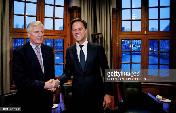 Dutch Prime Minister Mark Rutte shakes hands with European Chief Brexit negotiator Michel Barnier for a meeting at the Torentje the official office...