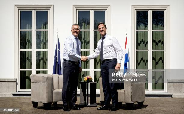 Dutch Prime Minister Mark Rutte shakes hands with NATO Secretary General Jens Stoltenberg upon his arrival at Catshuis in The Hague The Netherlands...