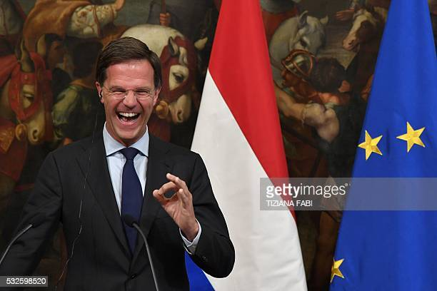 TOPSHOT Dutch Prime Minister Mark Rutte speaks during a joint press conference following a meeting with Italian Prime Minister Matteo Renzi on May 19...