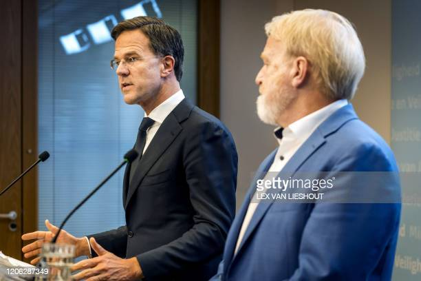 Dutch Prime Minister Mark Rutte speaks past director of the Center for Infectious Disease Control at RIVM Jaap van Dissel during a press conference...
