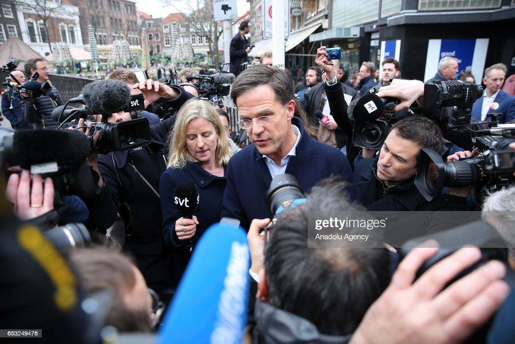 Dutch Prime Minister Mark Rutte (C) speaks to media ahead of the elections in The Hauge, Netherlands on March 14, 2017. Elections will take place on March 15, 2017.