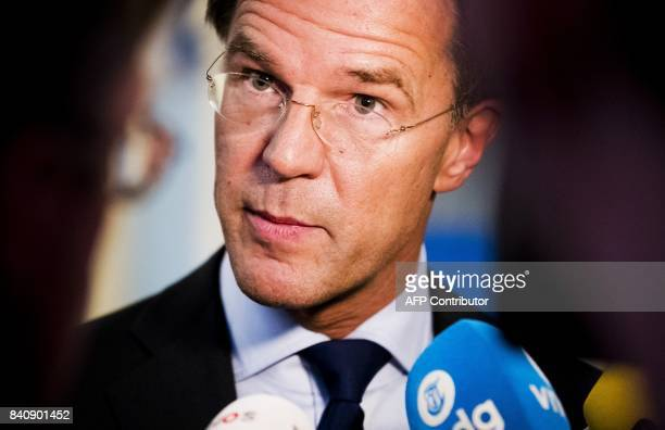 Dutch Prime Minister Mark Rutte speaks to the press after conciliation talks with coalition partner PvdA in The Hague on August 30 2017 / AFP PHOTO /...
