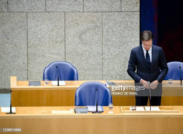 Dutch Prime Minister Mark Rutte stands during a commemoration following the massive explosion at the port in Beirut a week ago, at the Dutch Lower...