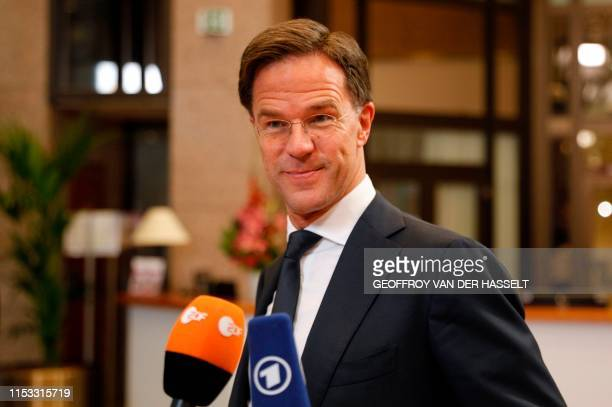 Dutch Prime Minister Mark Rutte talks to the media after the EU leaders struck a deal on the bloc's top jobs during the third day of a EU summit in...