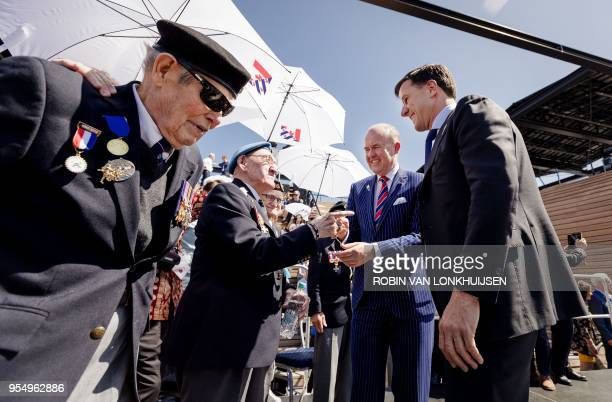 Dutch prime minister Mark Rutte talks with veterans in Leeuwarden on May 5 2018 during celebration to mark the beginning of the national celebration...