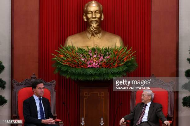 Dutch Prime Minister Mark Rutte talks with Vietnam's President and Communist Party General Secretary Nguyen Phu Trong in Hanoi on April 9, 2019.