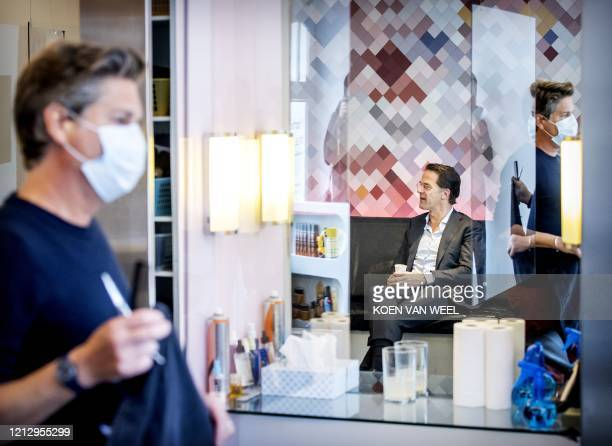 Dutch Prime Minister Mark Rutte visits a hairdresser in The Hague on May 14 2020 as Netherlands eases the lockdown measures taken to stop the...