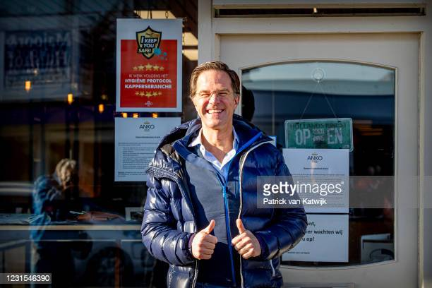 Dutch Prime Minister Mark Rutte visits his hairdresser Marco Rimmelzwaal after the re-opening during the lockdown in Leidschendam on March 6, 2021 in...