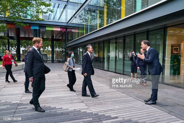 Dutch Prime Minister Mark Rutte welcomes Chinese Foreign Minister Wang Yi at the Ministry of Finance in the Hague the Netherlands on August 26 2020...