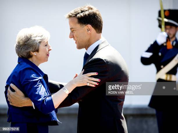 Dutch Prime Minister Mark Rutte welcomes his British counterpart Theresa May for a work lunch at the Catshuis The Hague on July 3 2018 The two heads...