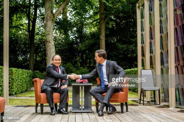 Dutch Prime Minister Mark Rutte welcomes his Vietnamese counterpart Nguyen Xuan Phuc for a work dinner at the Catshuis in The Hague on July 10, 2017....