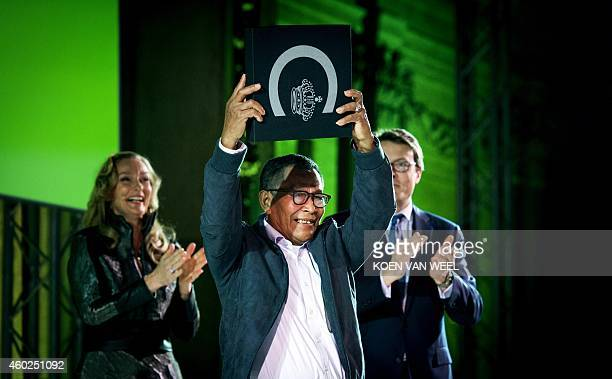 Dutch Prince Constantijn and Honorary President of the Prince Claus Fund and the Colombian artist Abel Rodriguez pose during the awarding of the...