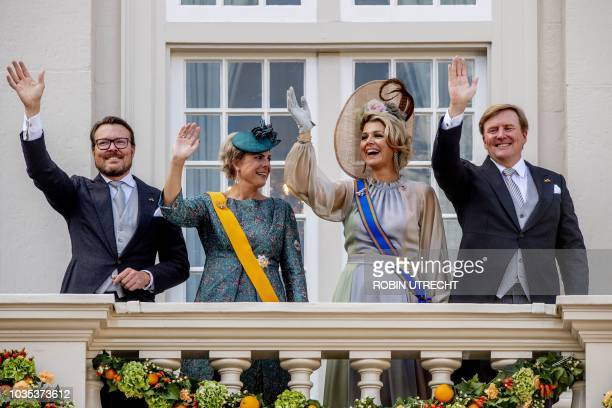 Dutch Prince Constantijn, Princess Laurentien, Queen Maxima and King Willem-Alexander wave to the crowd from the balcony of the Palace Noordeinde in...