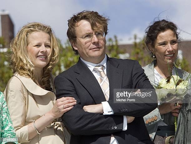 Dutch Prince Johan Friso stands with Princess Mabel and Princess Marilene during the traditional Queens Day celebratons on April 29 2006 in Almere...