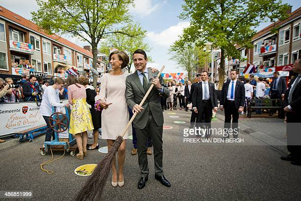 Dutch Prince Maurits and his wife Princess Marilene are sweeping the streets with a broomstick during the King's Day celebrations in Amstelveen, The...