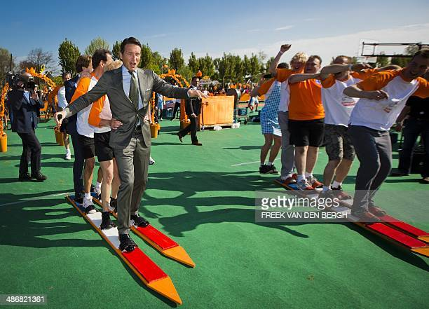 Dutch Prince Maurits takes part in the celebrations of the first-ever King's Day , the birthday of the king, in De Rijp, on April 26, 2014. AFP PHOTO...