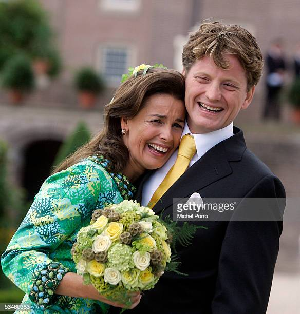 Dutch Prince Pieter Christiaan and Anita van Eijk laugh after they kissed after the civil wedding ceremony at The Loo Palace on August 25 2005 in...