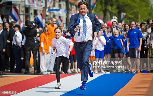 Dutch Prince Pieter Christiaan is running a sprint against a little girl during the King's Day celebrations in Amstelveen The Netherlands on April 26...