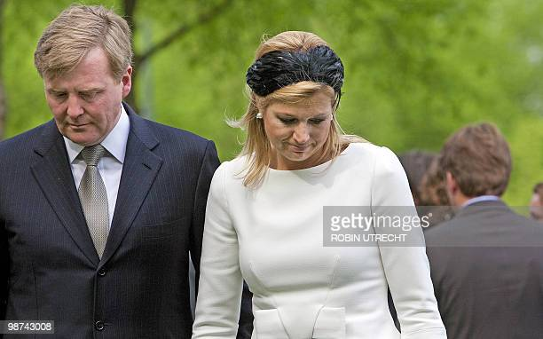Dutch Prince WillemAlexander and Princess Maxima attend on April 29 2010 in Apeldoorn a ceremony at the monument of remebrance for the victims of the...
