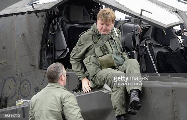 Dutch Prince WillemAlexander enters an Apache helicopter during a visit to the Defence Helicopter Command at Gilze Rijen airbase on November 13 2012...