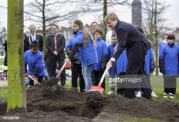Dutch Prince WillemAlexander plants the first Kings Linde together with a pupil of the Comeniusschool in the Hague on April 23 on the occasion of the...
