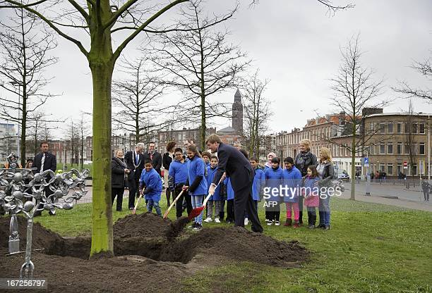 Dutch Prince WillemAlexander plants the first Kings Linde together pupils of the Comeniusschool in the Hague on April 23 on the occasion of the...