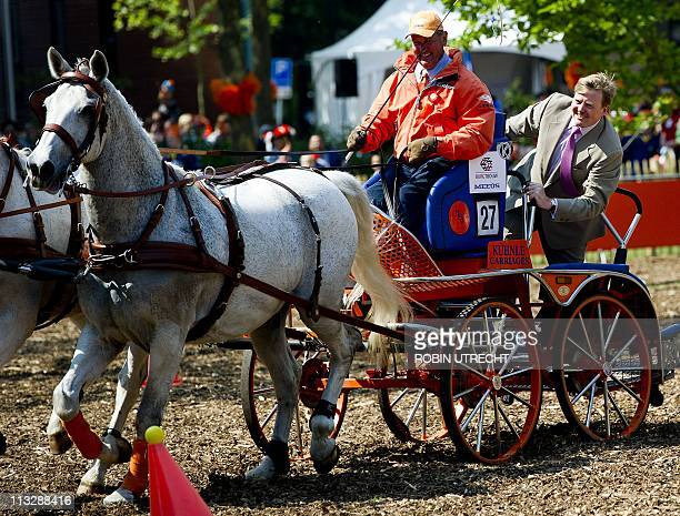 Dutch Prince WillemAlexander rides on a carriage during the Queen's Day celebration in Weert on April 30 2011 Queen's Day is a national holiday which...