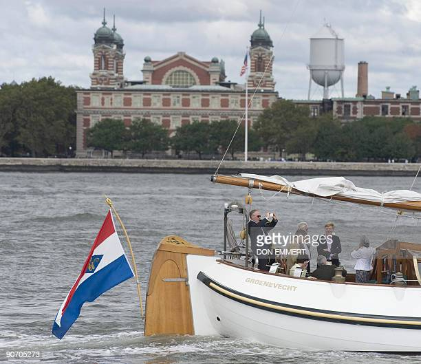 Dutch Prince WillemAlexander sails aboard the traditional Dutch boat Groenevecht past Ellis Island on September 13 2009 in New York Harbor The boat...