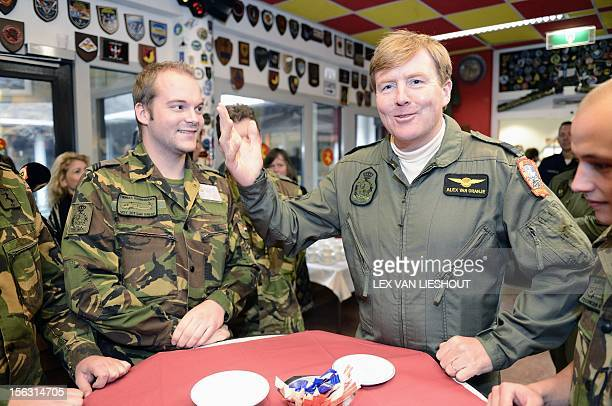 Dutch Prince WillemAlexander talks with soldiers during a visit to the Defence Helicopter Command at Gilze Rijen airbase on November 13 2012 The...