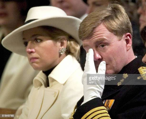Dutch Prince WillemAlexander wipes a tear sitting next to Princess Maxima during a funeral service for Prince Bernhard the father of Queen Beatrix of...