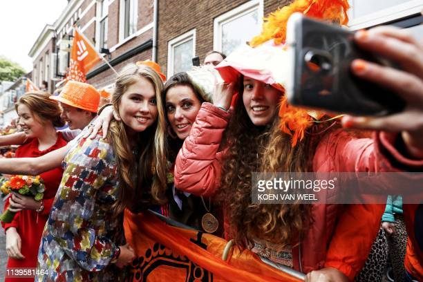 TOPSHOT Dutch Princess Amalia poses for a selfie in Amersfoort on Kings Day on April 27 2019 The king celebrates his birthday in the city in central...