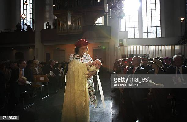 Dutch Princess Ariane is carried by the sister of Princess Maxima to her baptism ceremony in the Kloosterkerk in The Hague 20 October 2007 AFP PHOTO...