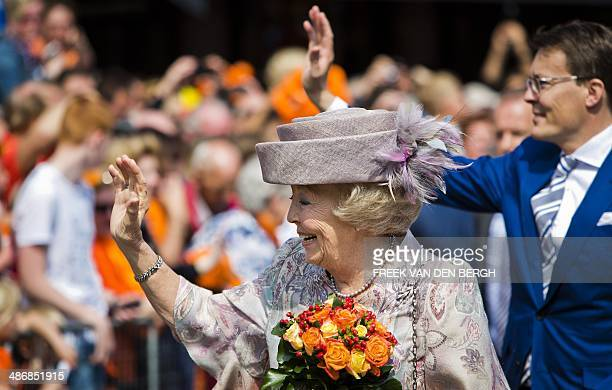 Dutch Princess Beatrix and her son Prince Constantijn wave to the public during the King's Day celebrations in Amstelveen, The Netherlands, on April...