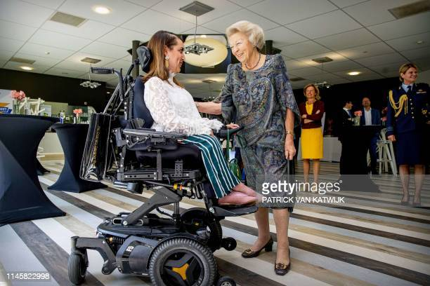 Dutch Princess Beatrix speaks with Hayat Afkyr, who suffers from spinal muscular atrophy, during the symposium Muscles2Meet on May 24, 2019 in Zeist....