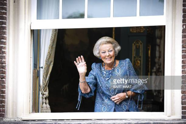 Dutch Princess Beatrix waves from Cabinet of the King during the 'Prinsjesdag' in The Hague, on September 18, 2018. - Prince's Day is the traditional...